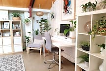 A comfortable place to work. Includes desk area, monitor and multiple USB and power supply outlets.
