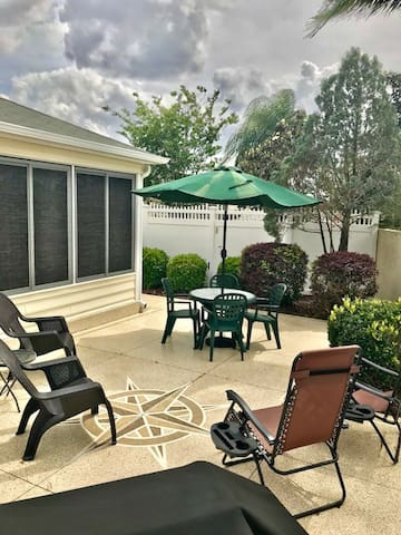 Back yard patio with lots of seating, gas grill and umbrella for those sunny afternoon barbecues.
