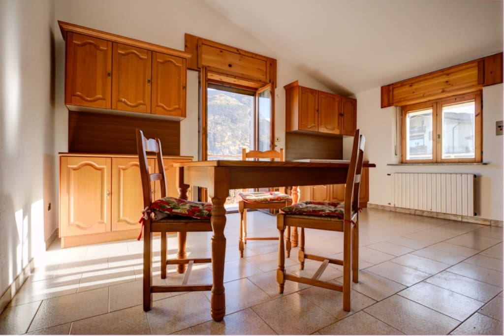 The confortable kitchen with balcony and beautiful panorama