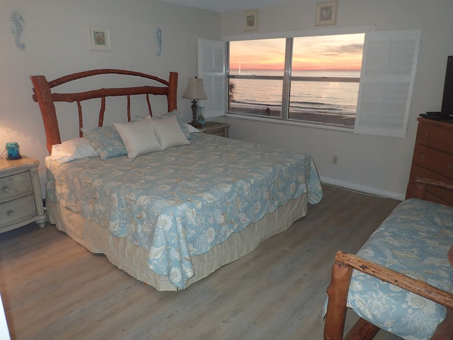 Watch the sunset from your upstairs beachfront master bedroom with king bed, 42 inch TV and DVD player