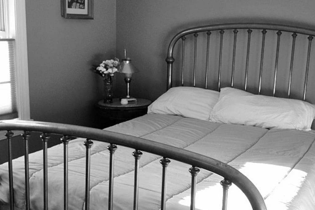 Brass queen bed with private bath