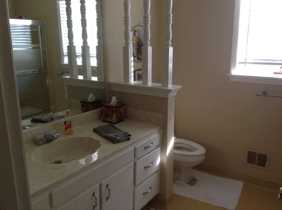nice shared guest bathroom with tub & shower.