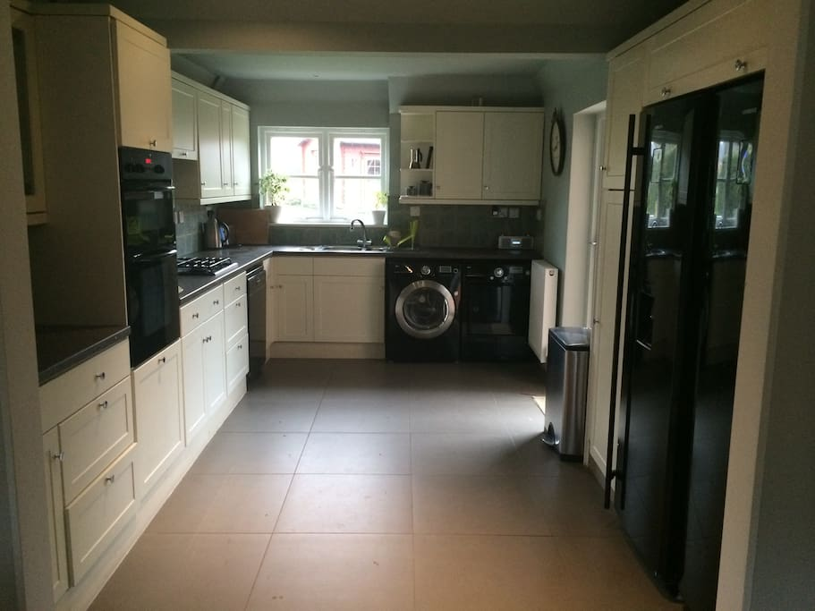 Well equipped kitchen with views of back garden and playing fields beyond.