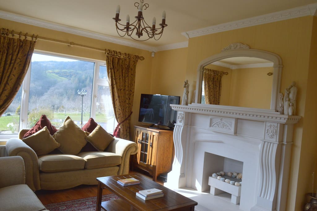 Cosy, spacious Sitting room with stunning Sandstone fireplace, Smart TV, Sky, Fridge and tea & cofee making facilities