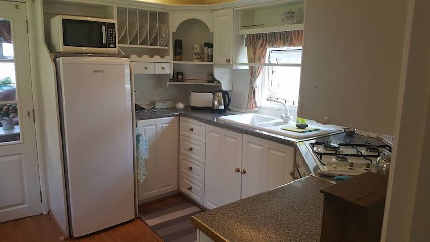 Kitchen - complete with cooker, dishwasher, fridge