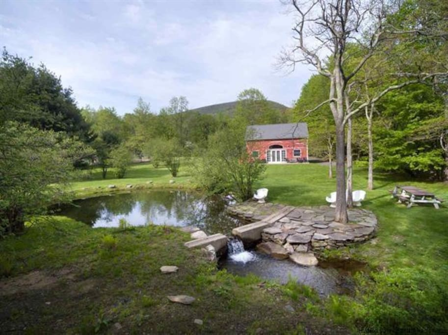 Pond waterfall with picnic table and stone patio