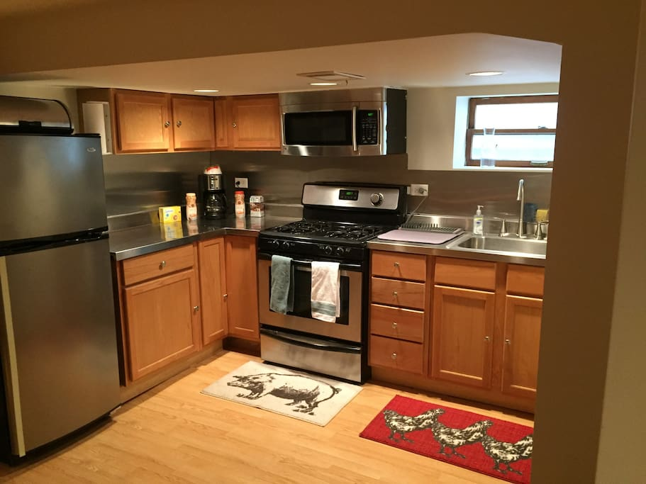 A full kitchen with stainless steel appliances, at your disposal.