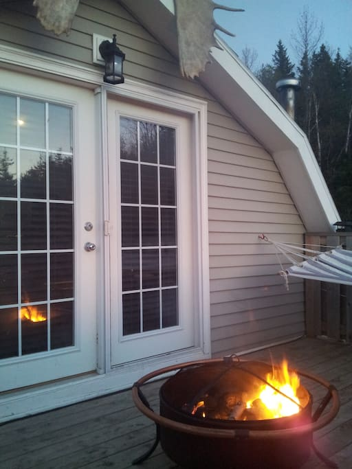 Large top deck with fire pit, chairs and hammock:)
