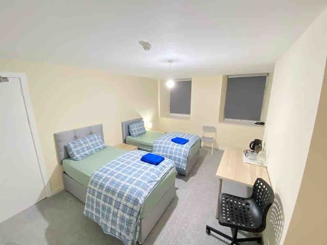 Large room with twin Bed