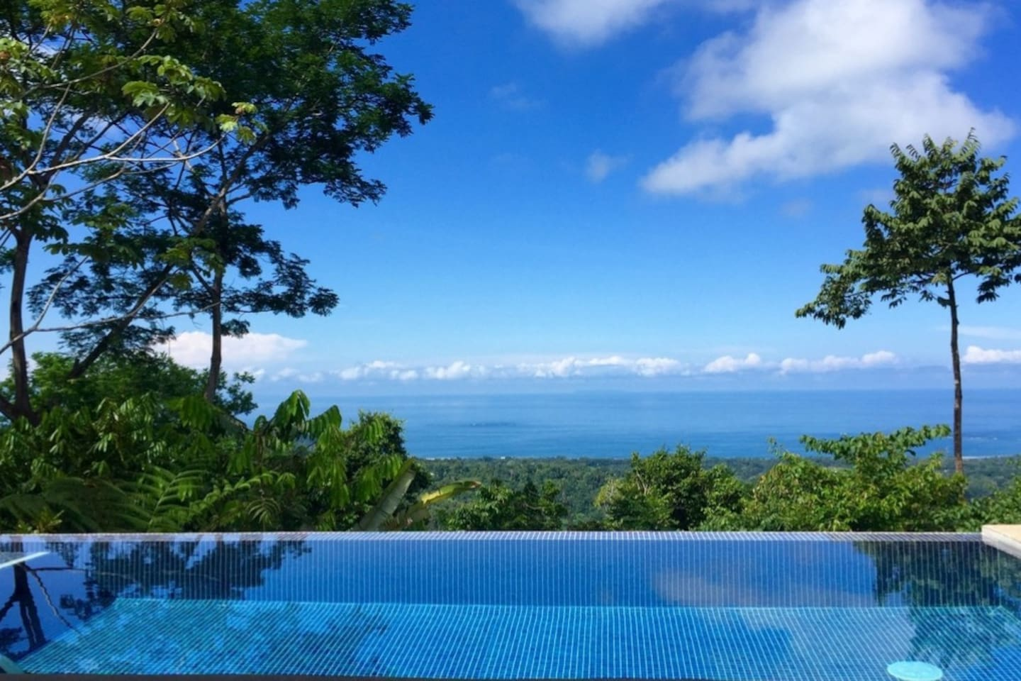 Romantic Uvita getaway.  Infinity pool with spectacular ocean and coastal views while nature abounds in the rainforest canopy just below you.