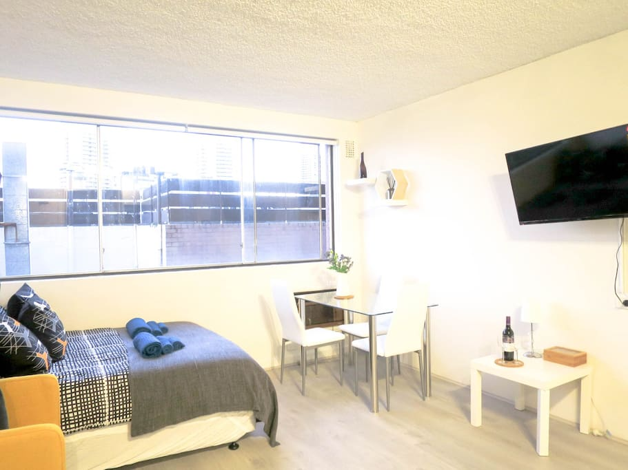Very spacious area with bed, lounge set, dining table/desk, 39 inch tv... and the best part of it .. its all new!