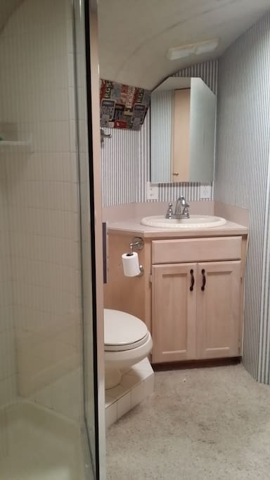 Bath with two closets for hanging clothes
