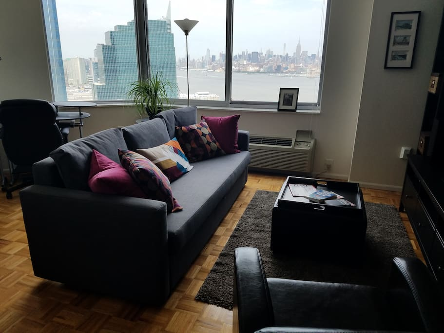 Living room with a sleeper sofa that accommodates 2 people