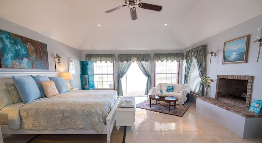 Large master bedroom opens to deck over looking the beach and also enjoys a fireplace, walk in closet and beautiful ensuite bathroom.