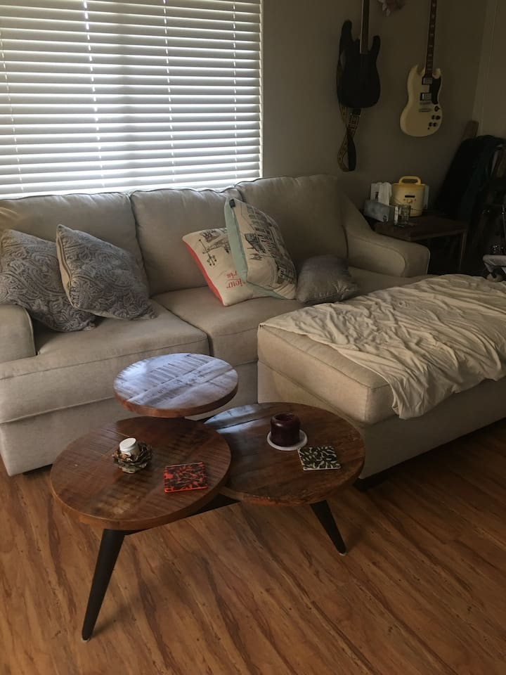This sofa bed turns into a comfortable bed with mattress that sleeps two. We have plenty of comfortable bedding, sheets, pillows, etc.
