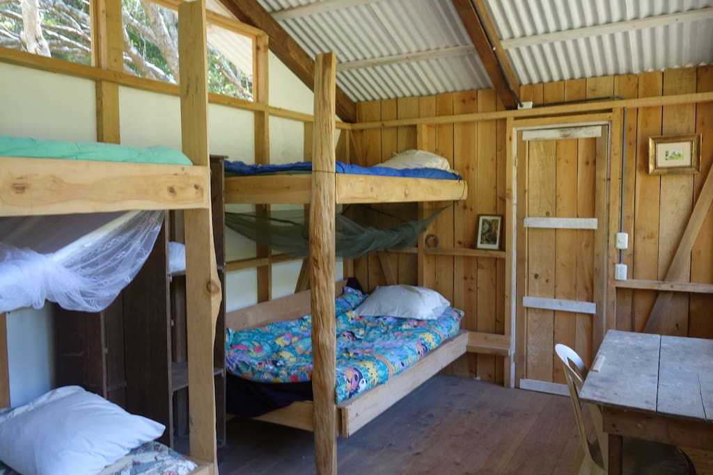 Four bunks.  One bottom bunk can be pulled out to become a double.