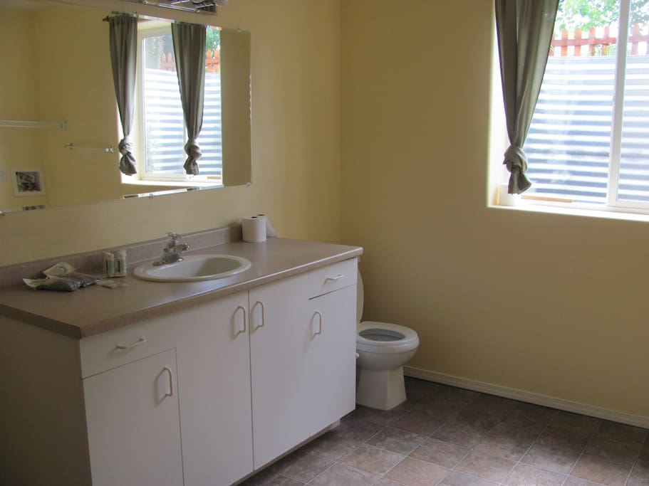 Roomy bathroom with shower bath.