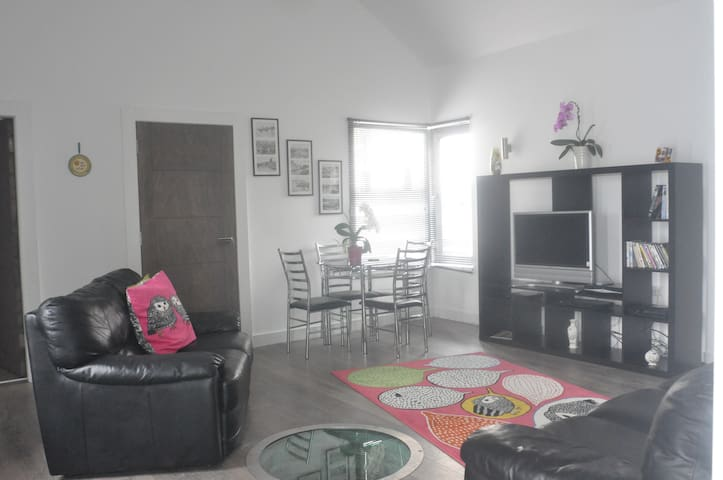 Living and dining area complete with satellite TV and Wi-Fi upon request