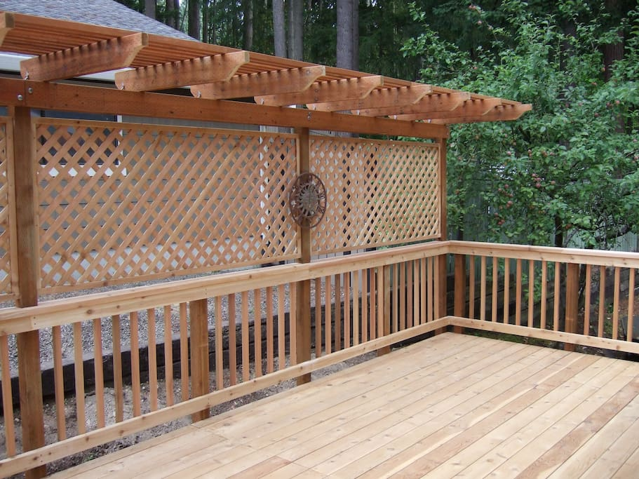 Here's our deck, right off the dining room.  The deck furniture isn't out yet, but it can seat over a dozen people, and we have an outdoor dining table as well.