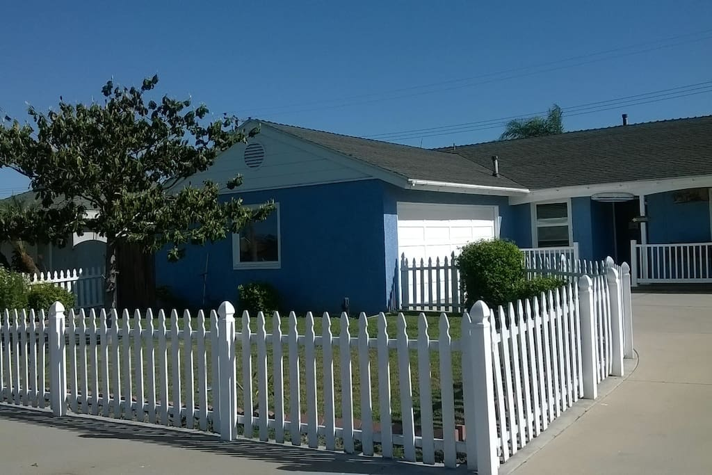 Enclosed front yard with a white picket fence