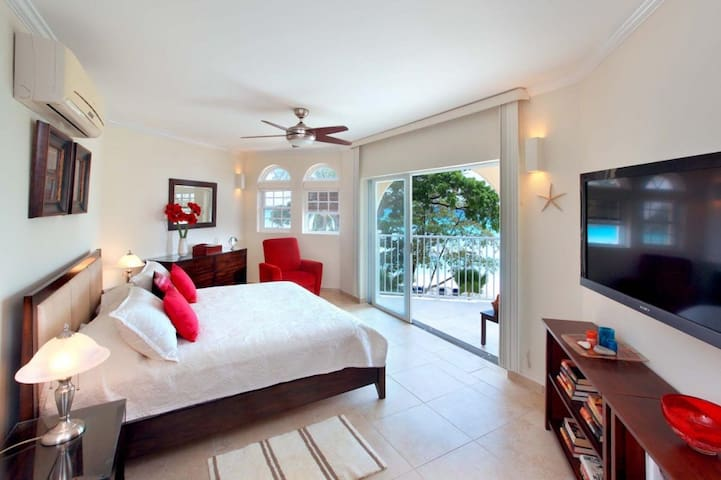 Master bedroom with king size bed & cable TV opens onto the covered 200 sq.ft. terrace.  ALL RENTAL RATES ARE SUBJECT TO THE BARBADOS GOVERNMENT'S 10% SHARED ECONOMY LEVY.