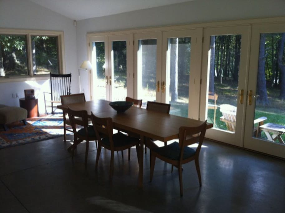 Dining area looking out towards the woods and the lake.