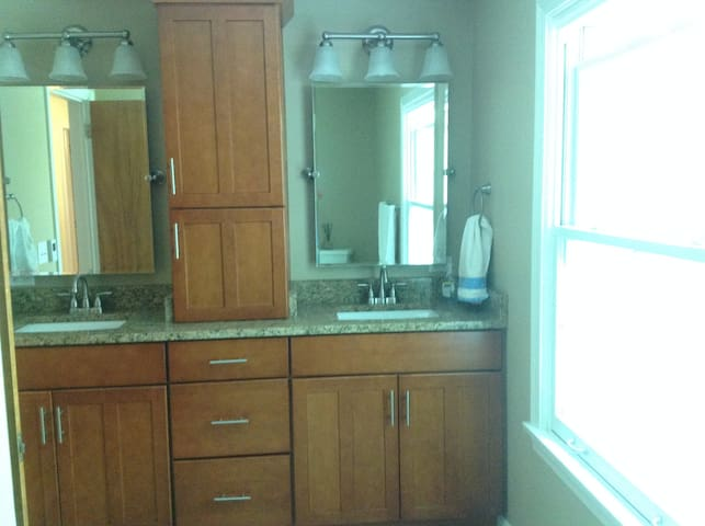 Upstairs bath with double sink.