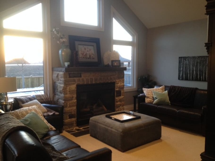 Family room with gas fireplace and cathedral ceilings