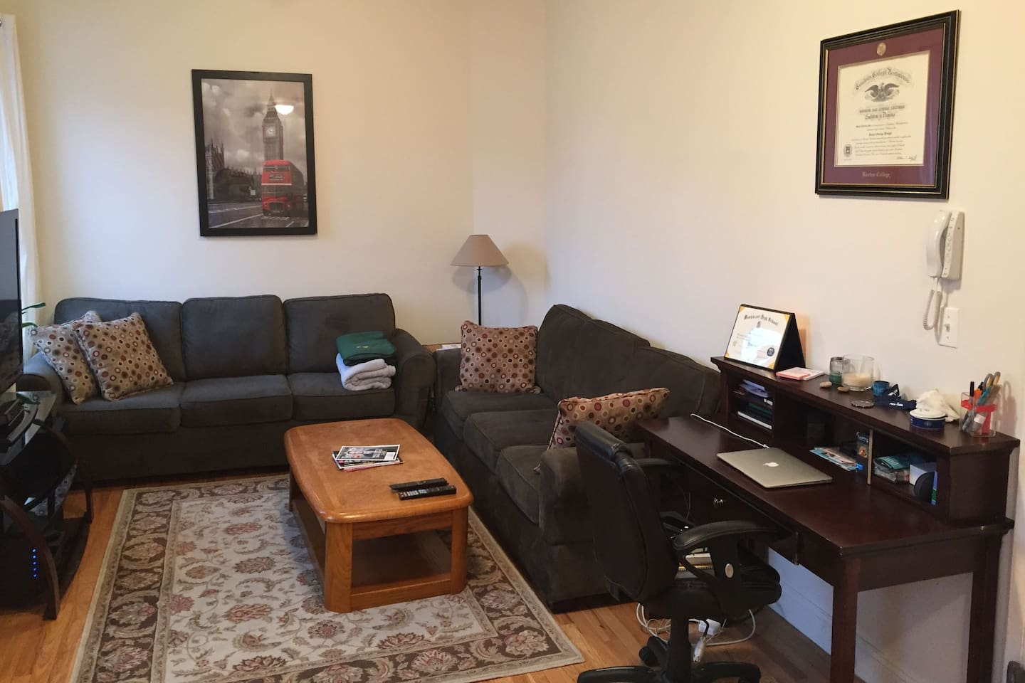 Very large living room! Two large couches, coffee table, entertainment console, and full desk.