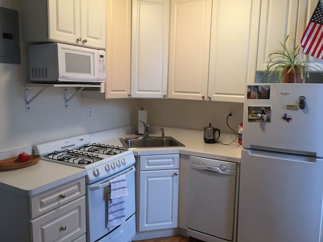 Spacious kitchen with full stove, oven, microwave, dishwasher, fridge, and plenty of kitchen supplies should you wish to use them.