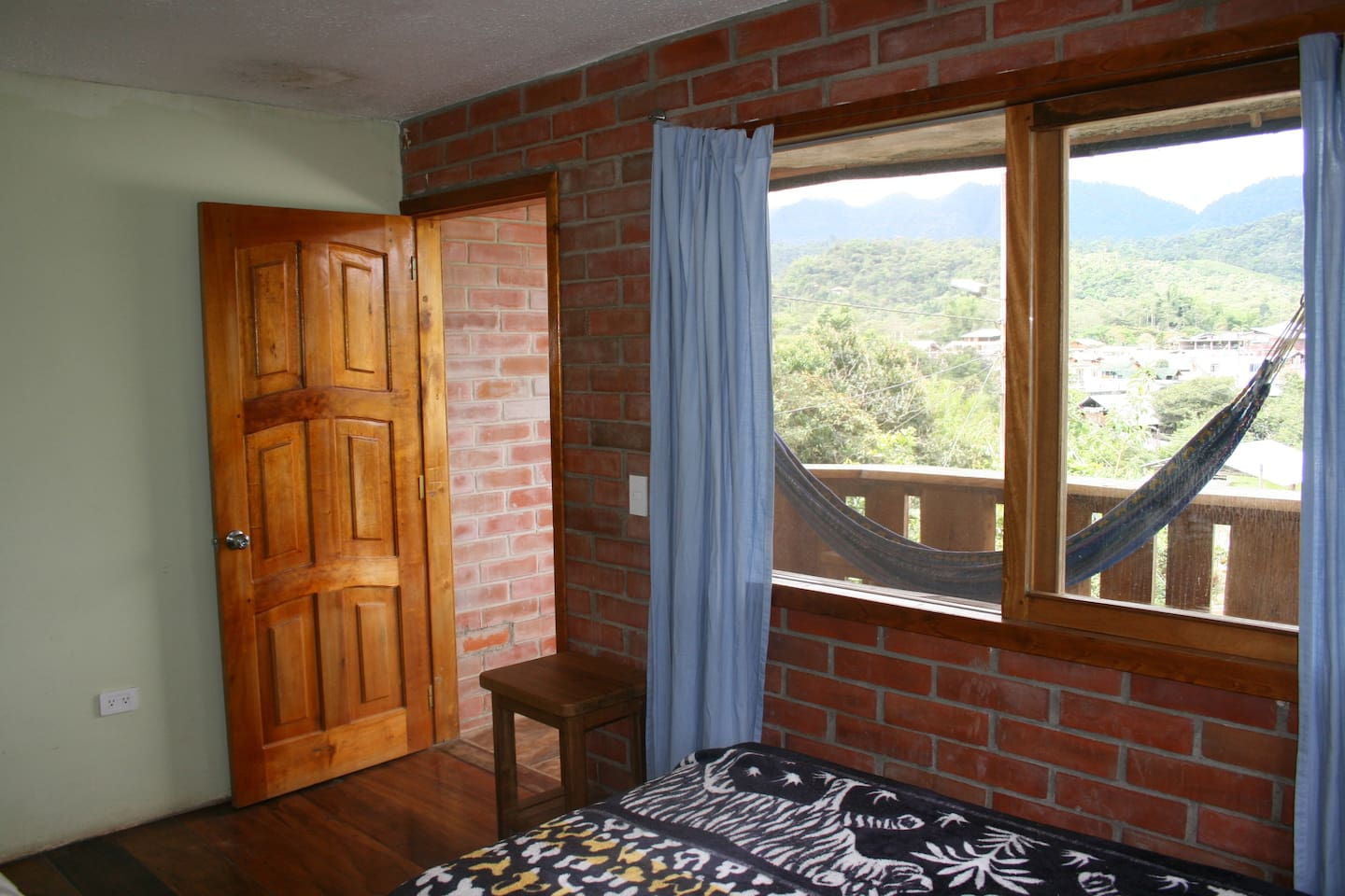 Mindo Chocolate Balcony room a great place to relax with a mountain and river view.