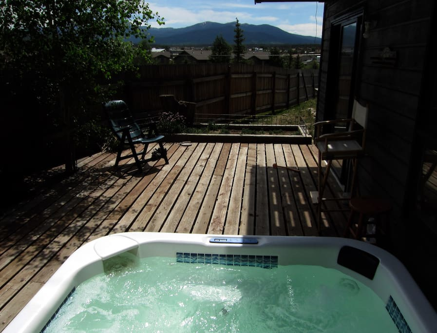 Outdoor hot tub with mountain views