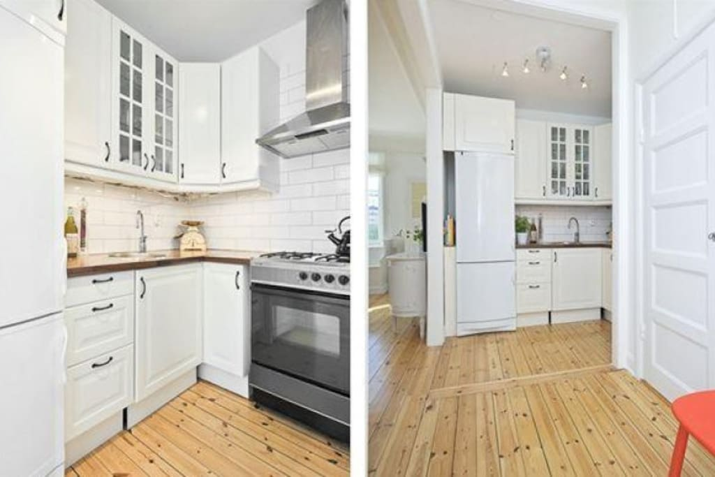 Kitchen with gas hob and stove, fridge and freezer.