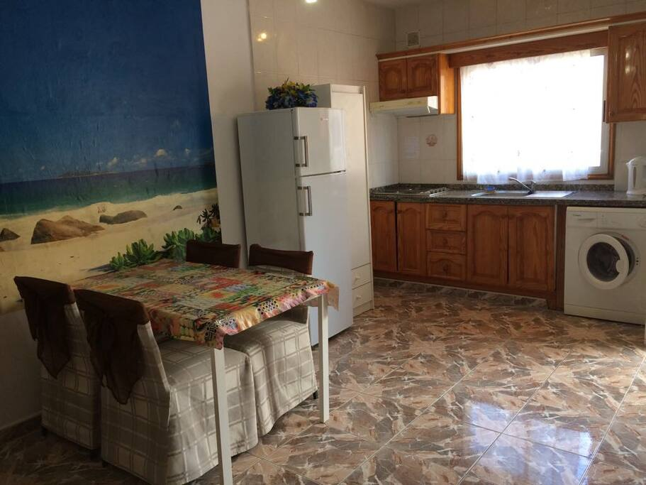 Open kitchen with exterior window and new washing machine