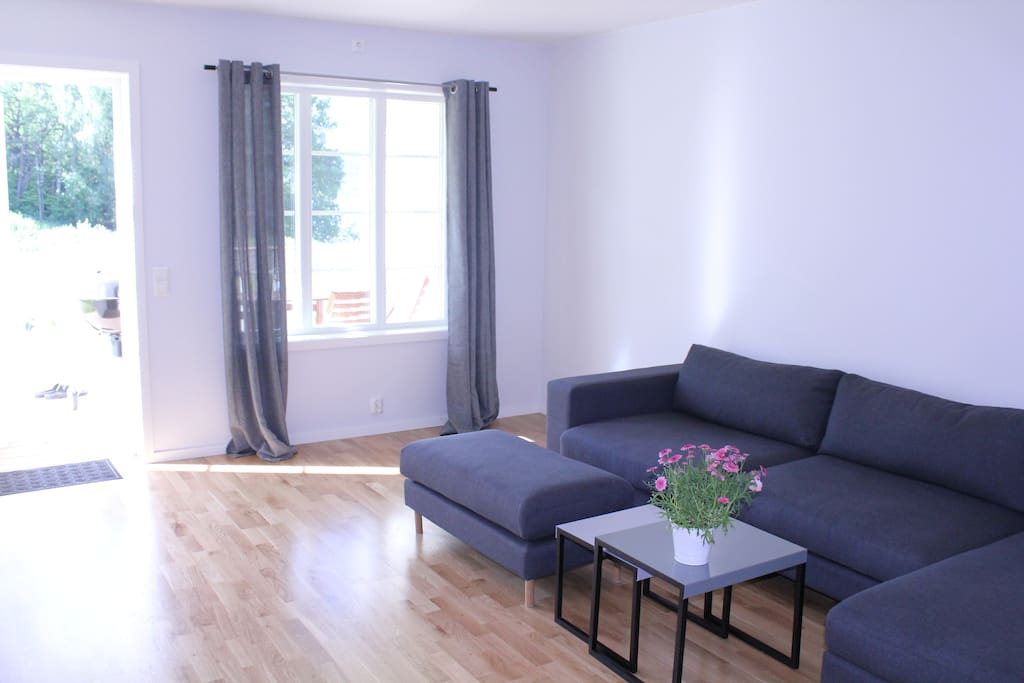 Very comfortable living room with cable TV, Wifi and large windows and door out to the balcony and garden.  Perfect for relaxing days.