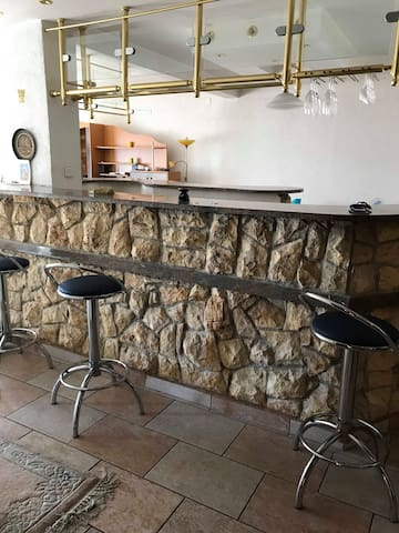 living room with bar counter design