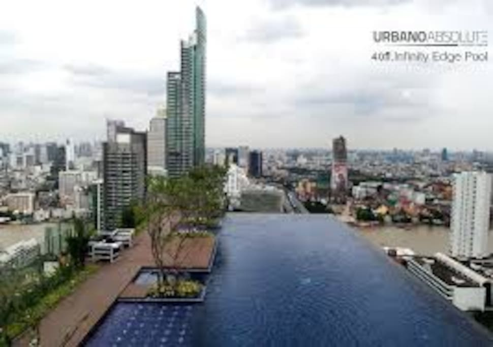 Infinite-edged pool with panoramic view of Choaphraya river on the roof-top floor