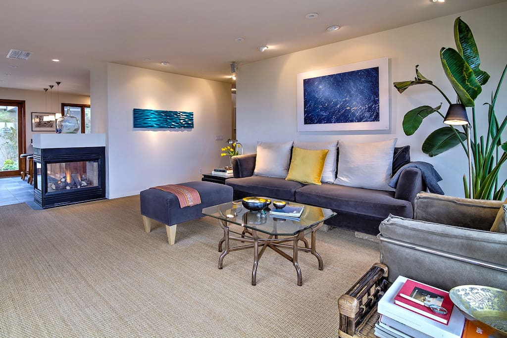Lounge on the stylish living room furniture next to a double-sided gas fireplace.