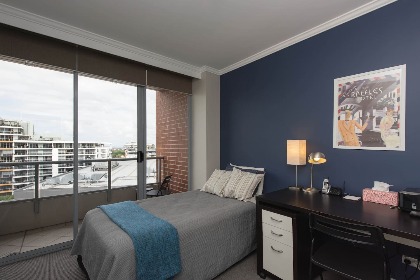 King single bed with work space and balcony