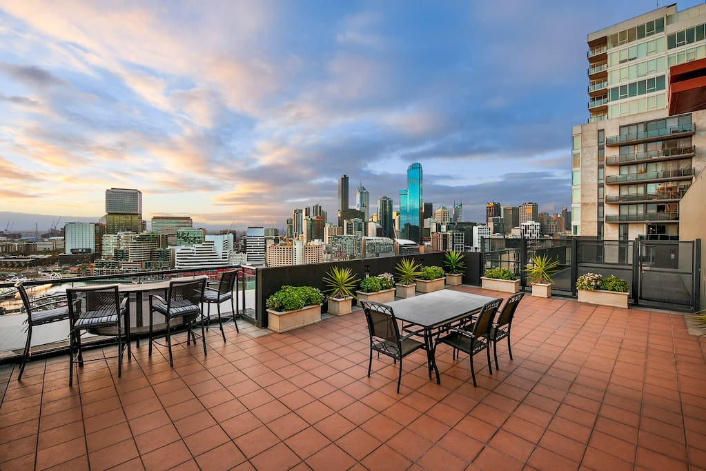 A private balcony and terrace overlooking the iconic skyline.