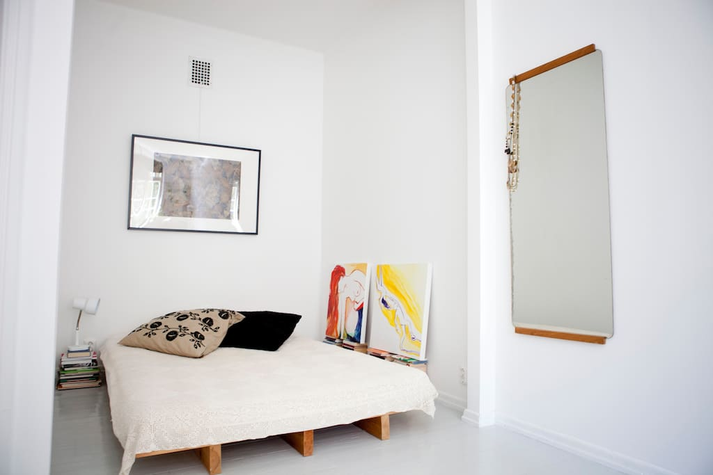 Living/bedroom with comfortable 140cm wide bed.