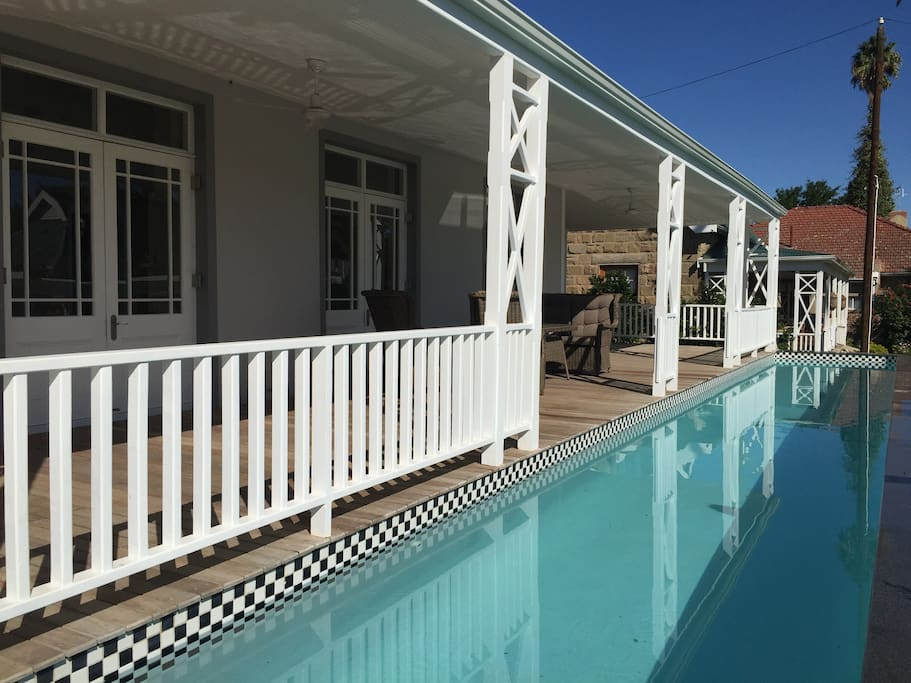 Private lap swimming pool and covered patio