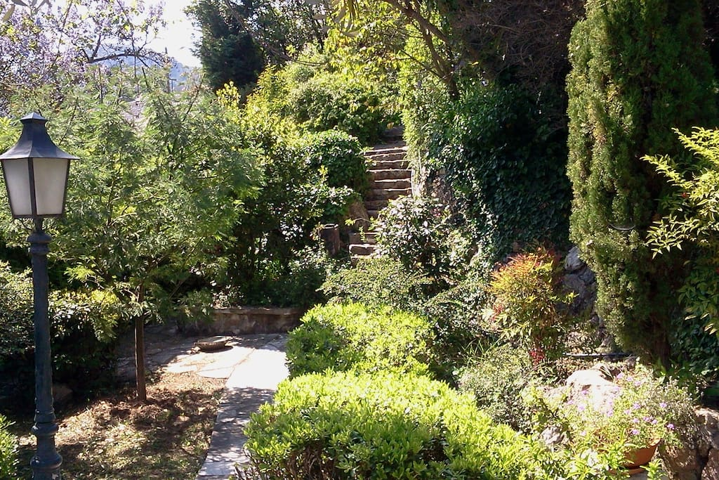 private garden on the level of the apartment with the ascending stairs to the upper level gardens.