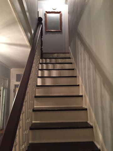 Your room is upstairs and all the way to the left.