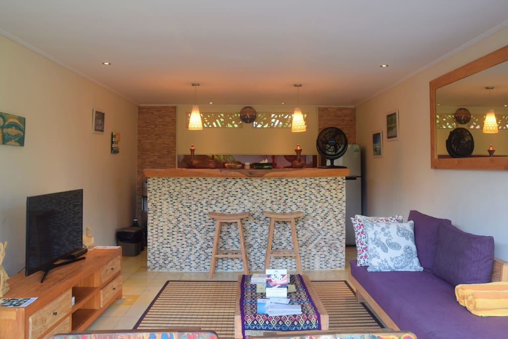 Living, kitchen and tv room