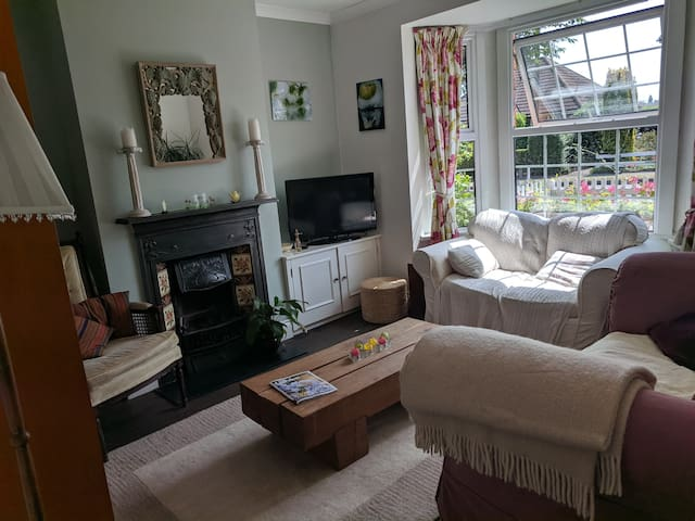Guests are welcome to share the comfortable sitting room, which has a TV.  In winter I light the fire.