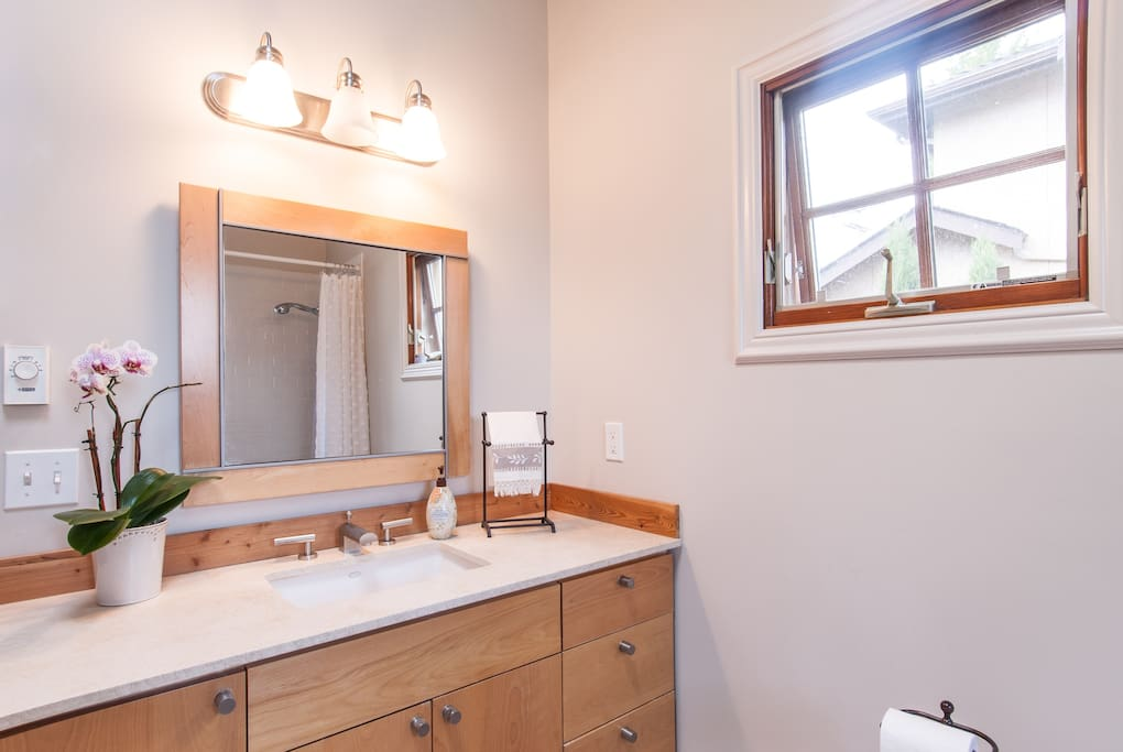 Very private full bath with natural light and lots of drawers for storage