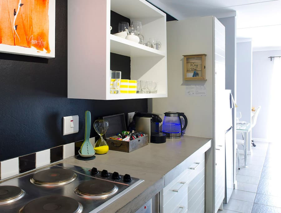 The fully equipped kitchen has all the necessary utensils to meet your cooking and dining needs.