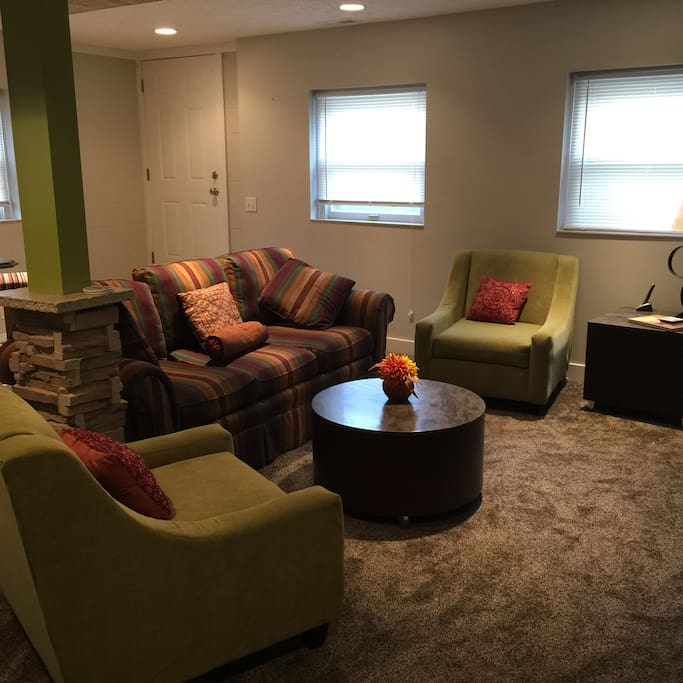 Private living room located in basement apartment