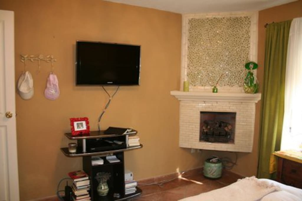 "Fireplace, 32"" flatscreen and AppleTV, DVD Cable TV, Internet in bedroom"
